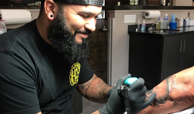 Luis Morales tattooing
