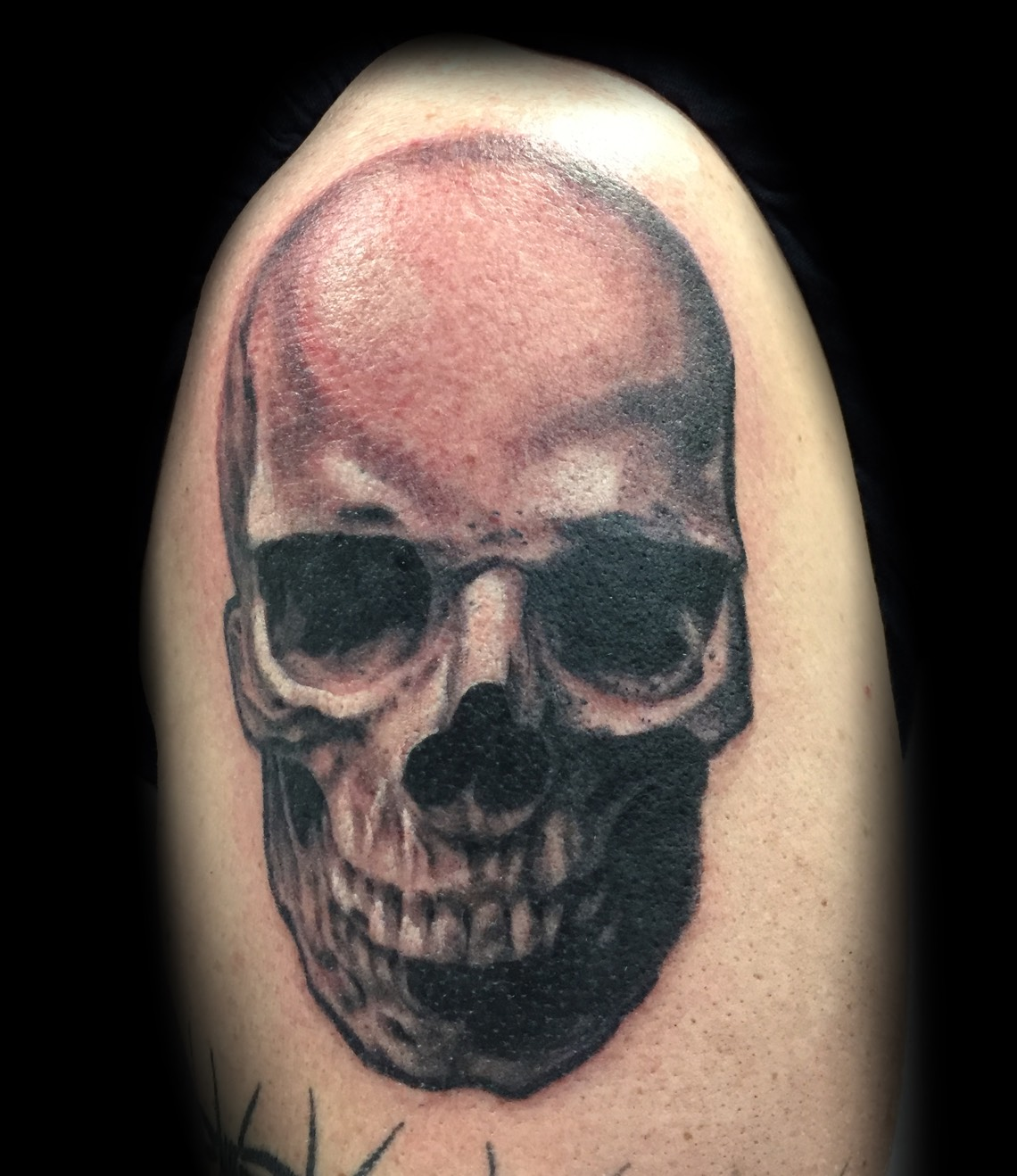 Dustin Quillen's skull tattoo